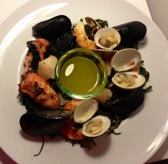 One evening's dinner featured grilled seafood on bed of steamed spinach - I wish you could try a bite!