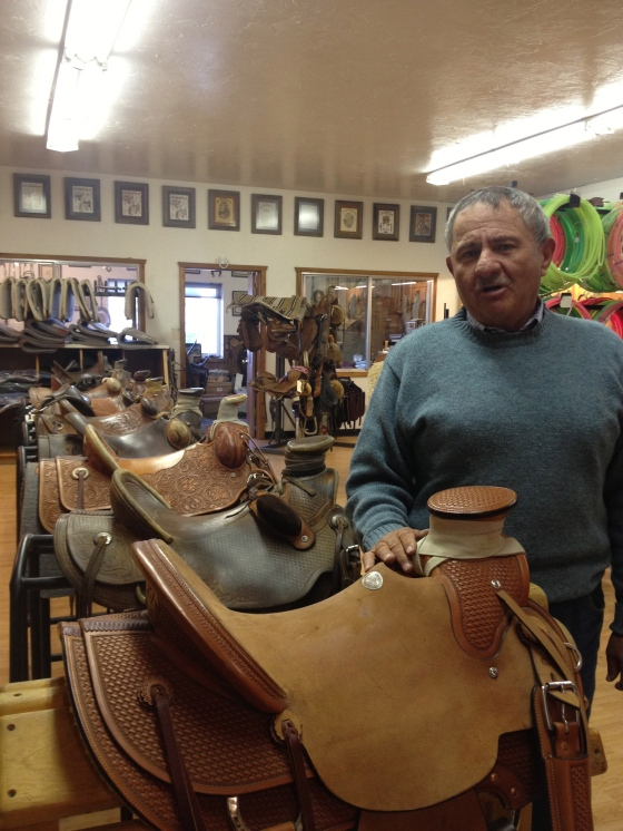 This is Doug, the owner standing by all the hand-crafted saddles.