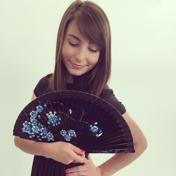 Model Hayden in a tu-anh original dress and a hand-painted fan from Spain.